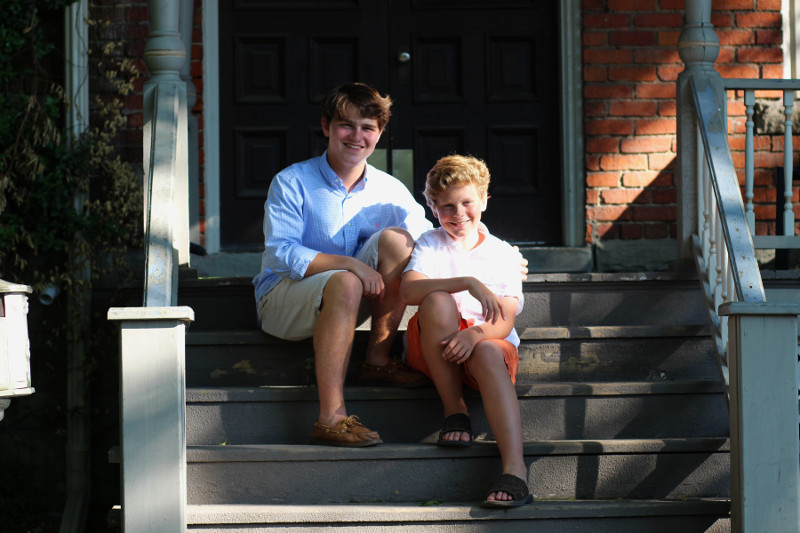 Two brothers sitting on porch steps