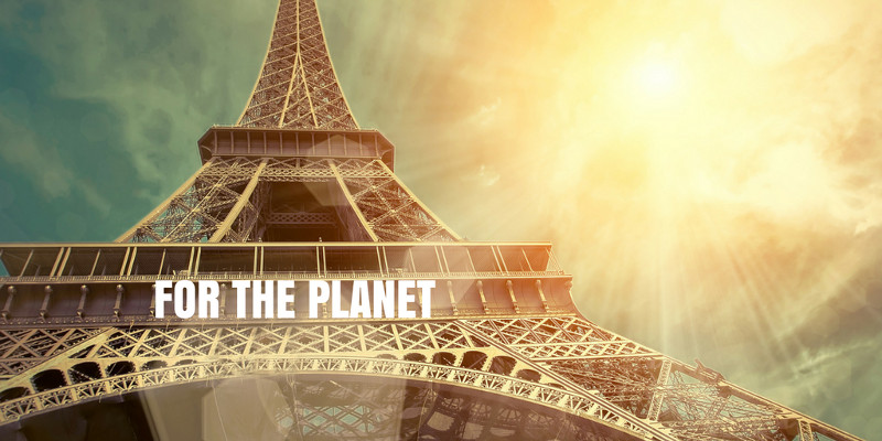 """Image of Eiffel Tower with """"for the planet"""" text across it"""