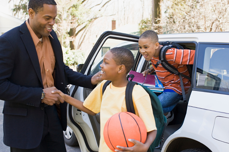 dad helping kids out of car