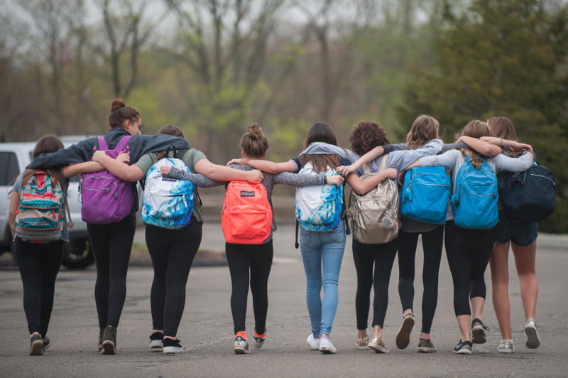 GoKid Pro announcement - image of row of girls in backpacks